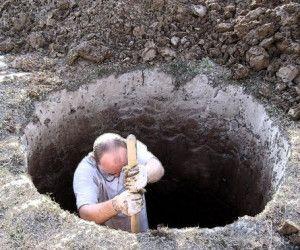 Подготовка ямы для погреба из бетонных колец